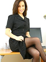 Secretary Pics: Sexy Mel slowly teases her way out of her secretary outfit in the office