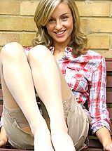 Stockings Pics: Melanie wearing a checked shirt and a cream mini skirt with white stockings and cotton panties.