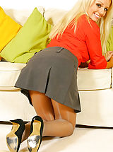 Only Tease Pics: Busty blonde Elena in a smart secretary outfit with thong and pantyhose.