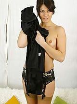 Tiny Skirts, Abbi in black evening dress with tan stockings