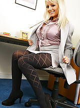 Only Tease Pics: Beautiful blonde in smart secretary outfit with pretty patterned pantyhose.