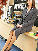 Secretary Pics: Melanies perfect figure is flattered by the sexy lingerie under her suit skirt and blouse