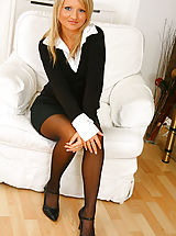Office Sex, Blonde beauty Liana Lace relaxes on her sofa in nothing but holdup stockings.