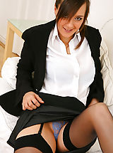 Mini Rock, Stunning executive secretary Nadia E finishes off her work and then undresses from her sexy skirt suit