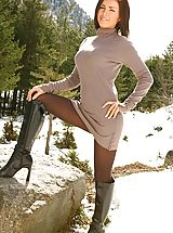 Stunning Gemma M teasing her way out of beige mini dress with brown tights and boots