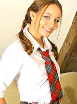 Carla wearing a sexy college uniform with a tartan skirt and white ankle sock and cotton panties