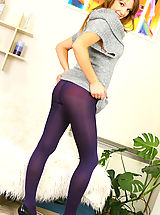 Between Her Legs, Sexy Jasmine wearing a small minidress with purple pantyhose