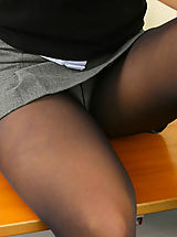Pantyhose Pics: Sexy brunette Uma wearing her college uniform and pantyhose