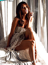 Valentina Vaughn looks stunning in wedding white smoking a ciggy.