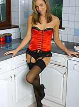 High.Heels Pics: Melanie in red satin basque with black stockings