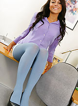 Beautiful brunette Bethany in a smart office outfit with blue pantyhose.