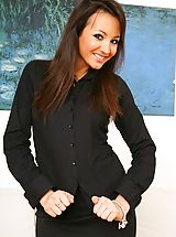Only Tease Pics: Gorgeous brunette Rachael B in a sexy black secretary outfit and patterned pantyhose.