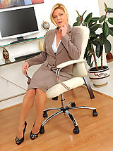 Classy Legs, Mature Ginger Lynn tames her horny pussy with her vibrating wand toy while she is alone in the office
