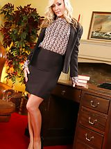 Blonde slips out of her tight black knee-length skirt suit and reveals her sexy lingerie.