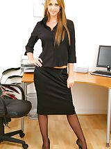 Between Legs, Blonde secretary slips out of skirt and sexy lingerie. Non Nude