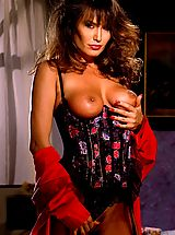 Lingerie Pics: Sexy Buxom brunette April O'Hara makes incredible shapes to Suze's incredible erotic eye.