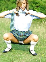 under skirt, Melanie takes a wander in the park wearing a college uniform consisting of tartan skirt