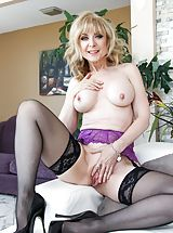 clubwear stockings, Bill Bailey, Nina Hartley Sizzling Woman reveals her naked juggs, pulls down her panties and opens her legs and hand fucks her tight cunt