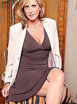Hot Secretary, Pretty blonde cougar shows off her cleavage and begins to strip