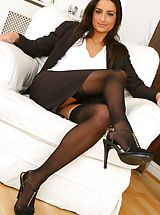 Gorgeous brunette Isla looks stunning in her sexy brown secretary outfit Non Nude