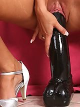 Leather Heels, Slut fucks two huge dildos