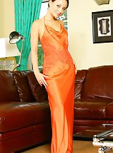 Secretary Pics: Carla in a stunning orange evening dress