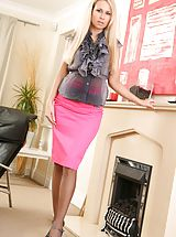 Gorgeous blonde wearing a grey opaque blouse with a long pink skirt. Non Nude
