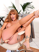 UK Playmates Pics: Darla Crane, Brunette Anilos Darla Crane stretches her mature pussy with a glass toy in the office