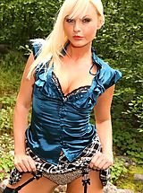 Sandra looks stunning in her blue top with a tartan miniskirt and stockings.