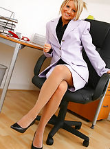 UK Playmates Pics: Adorable Liana Lace slowly removes her sexy secretary outfit in her office revealing her grey
