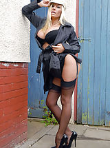 Michelle is not your usual flasher type, but more the shame! In her back garden she does a strip down to her kinky latex garter belt and black Harmony Point full fashion nylons, poised on classic 6
