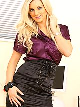 Secretary Pics: Beautiful Meklaina dressed as a secretary wearing a blouse and a skirt but more importantly some sexy lingerie underneath.