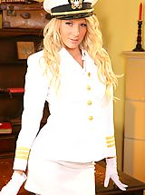 Cute Ashlea looks wondeful dressed in her white uniform and matching white lingerie.