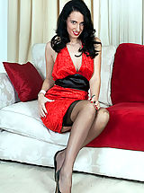 Naughty Office, Tammy, long legs, sheer black nylons, spike heels,and a tight black vintage girdle.