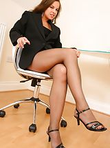 Legs, Michaela looks amazing as she seductively teases her way out of her gorgeous pinstripe jacket and mini dress to reveal her sexy brown pantyhose Non Nude