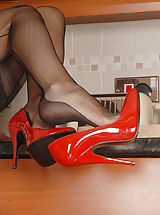 Platform Heels, Undressed Housewife in Lingerie We catch Saffy in the kitchen, yet not working for long! Play is more fun, and the Essex chick in red stiletto s is able to play! Quickly showing all this trim curvy babe is a delight in bullet boobie harness, vintage power