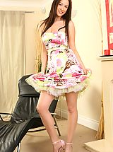 Naughty Office, Brunette Carole wearing a beautiful and colourful summer dress.