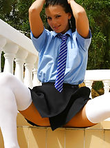 Mili looks great in college uniform with white over the knee socks