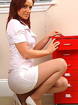 Sexy Secretaries, Kinky redhead teases her way out of her work clothes and poses over her desk.