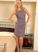 Hot Secretary, Elle is wearing a shift dress with tan stockings
