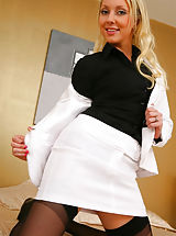 Sexy Secretaries, Jessie looks delightful in her white skirt suit and dark stockings