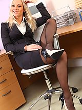 Long Legs, Tammy looks smart and sexy in her black skirt suit.