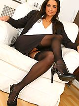 Secretaries, Gorgeous brunette Isla looks stunning in her sexy brown secretary outfit