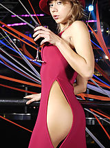 Hot blond babe Tara undressing on the stage in disco club