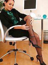 Only Tease Pics: Gorgeous brunette Carla shows off the stunning body beneath her office clothes.