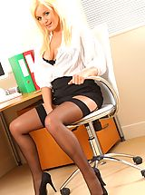 Sexy Secretary, Amy Green takes a break from her office duties to do a sexy strip.