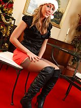 Secretary Pics: Darcy looks a real treat in her knee high boots and red miniskirt.