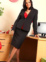 Abbie teases her way from office outfit with red and black suspenders
