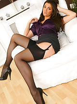 Natalia looks gorgeous as she teases her way out of her sexy secretary�s outfit Non Nude