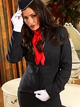 Hot Legs, Gorgeous dark haired air hostess teases in her tight skirt suit before stripping down to her panties